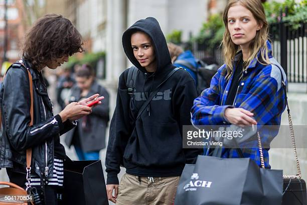 Fashion models Mica Arganaraz Binx Walton and Lexi Boling after the Coach show during London Collections Men AW16 on January 09 2016 in London England