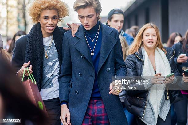 Fashion models Michael Lockley and Lucky Blue Smith outside Etro during Milan Men's Fashion Week Fall/Winter 2016/17 on January 18 in Milan Italy