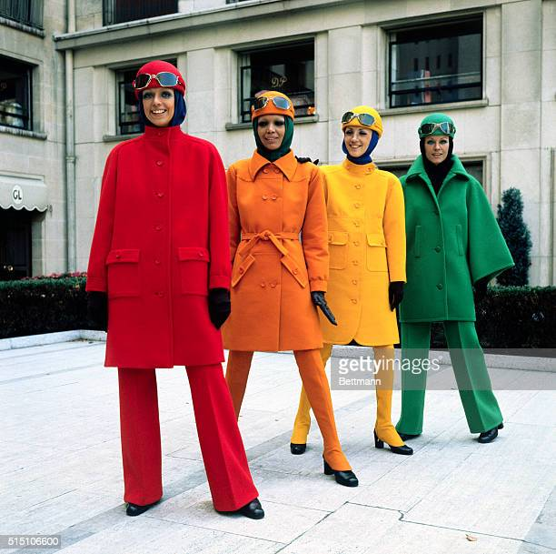 Fashion models model brightly colored sports coats with matching hats and slacks or long spat type stockings by Guy Laroche from his Winter and...