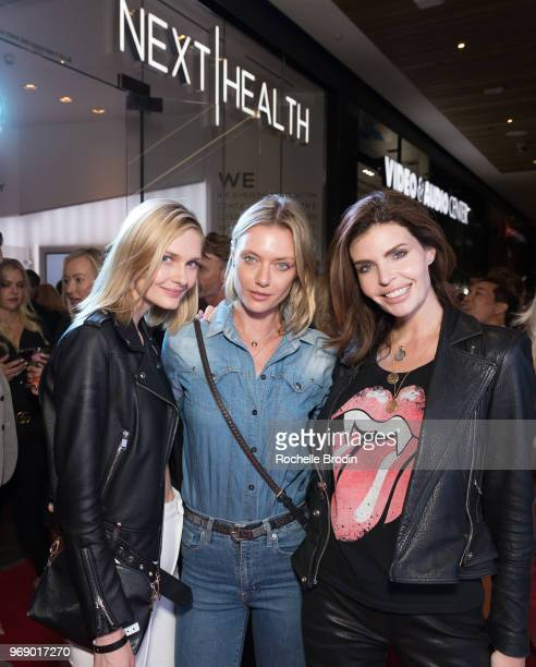 Fashion Models Olga Cerpita Anastassija Makarenko and Julia Lescova attend the Next Health Grand Opening at the Westfield Century City on June 6 2018...