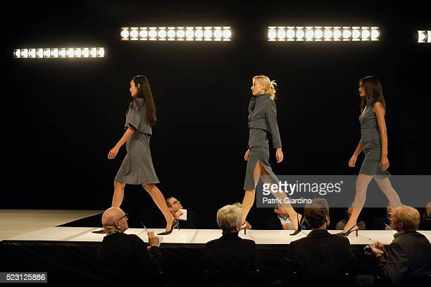 fashion models on runway - fashion runway stock pictures, royalty-free photos & images