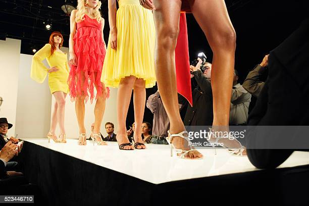 fashion models on runway - high fashion stock pictures, royalty-free photos & images