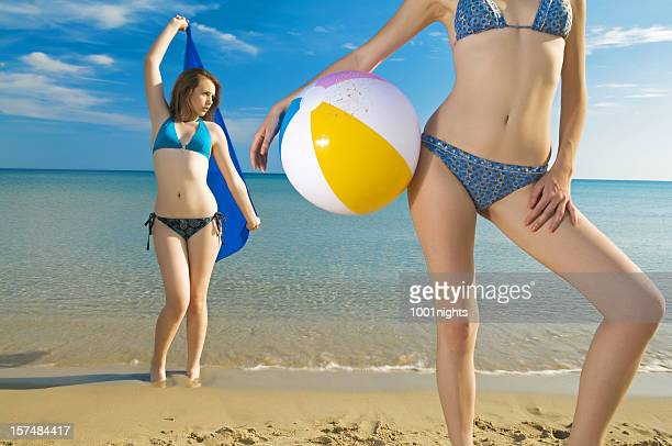 fashion models on the beach - skinny teen stock photos and pictures