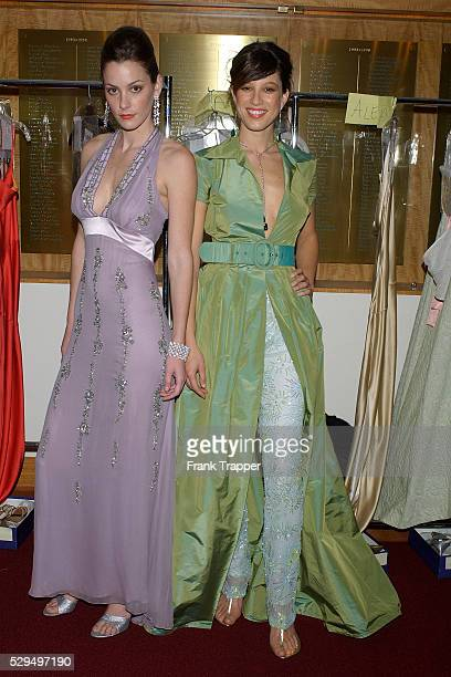 Fashion models Paz wears a Kevan hall green taffeta dress and beaded pant with Chopard you and me emerald and diamond drop earrings and Kelly wears a...