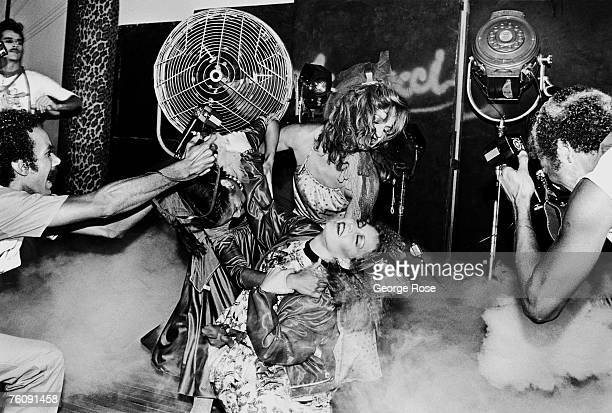 Fashion models perform in a mock fight during a punk fashion show at Fiorucci clothing store in 1979 Beverly Hills California