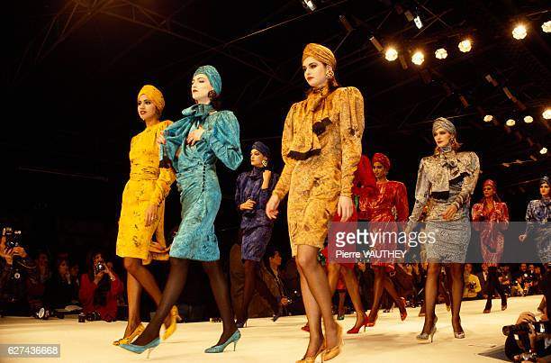 Fashion models wear bright colored suits with matching turbans by Japanese fashion designer Kenzo Takada at his autumnwinter 19861987 fashion show in...