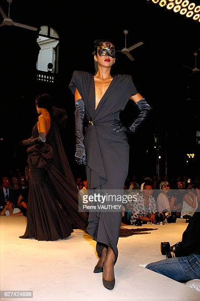 Fashion models wear strapless evening gowns and vneck cocktail dresses by French fashion designer Emanuel Ungaro at his autumnwinter 19861987 fashion...