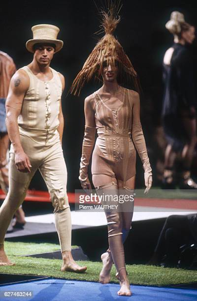 Fashion models wear women's and men's readytowear outfits and hats by French fashion designer JeanPaul Gaultier at his SpringSummer 1992 fashion show...
