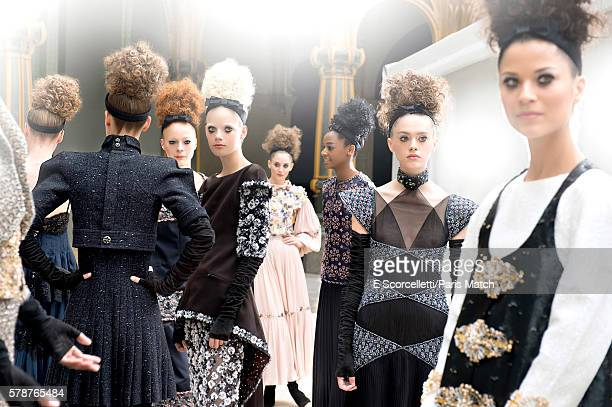 Fashion models wearing Chanel haute couture from the Autumn & Winter collection by Karl Lagerfeld are photographed for Paris Match at the Grand...