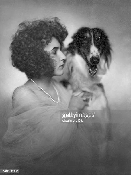 fashion Mrs Kranz with a chiffon stole a pearl necklet and her greyhound 1923 Photographer Edith Barakovich Published by 'Die Dame' 13/1923 Vintage...