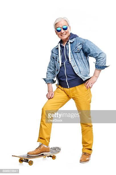 Fashion older men stamped on the skateboard