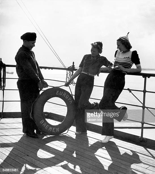Fashion on deck of the ship 'Bremen Europe' Two ladies in dark blue trousers and bluewhitered striped sweaters 1939 Photographer Karl Ludwig Haenchen...