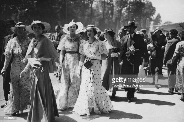 Fashion on the second day at Ascot Long dresses in various lightweight materials including spotted all worn with gloves and largebrimmed hats