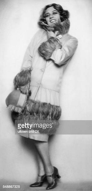 fashion operetta singer Lisa Kolbe in a short coat with feathers 1925 Photographer Edith Barakovich Published by 'Die Dame' 05/1926 Vintage property...