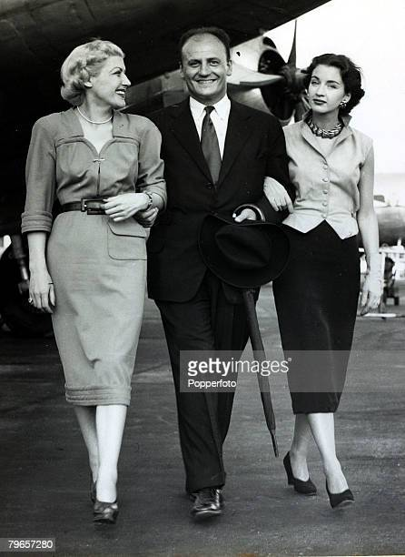21st August 1950 French fashion designer Pierre Balmain with a two of his models at London Airport MmeGiselle Gaillard left and Mrs Ruth McCullough...