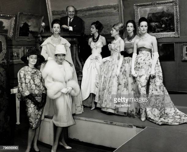 2nd May1960 French fashion designer Pierre Balmain with a group of his models at Sotheby's London auction rooms Pierre Balmain was known for his...