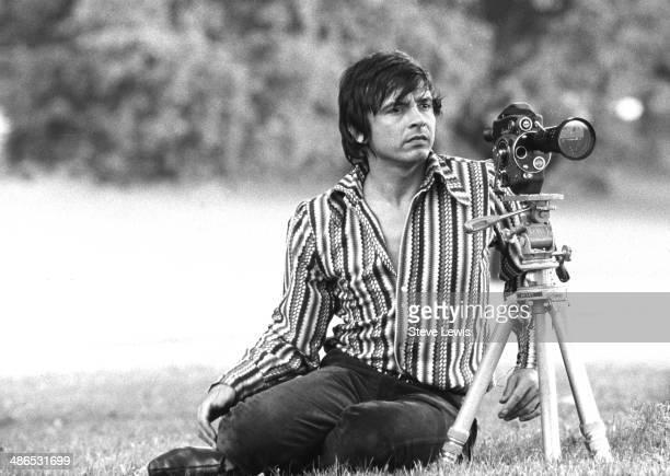Fashion photographer David Bailey with a film camera circa 1965