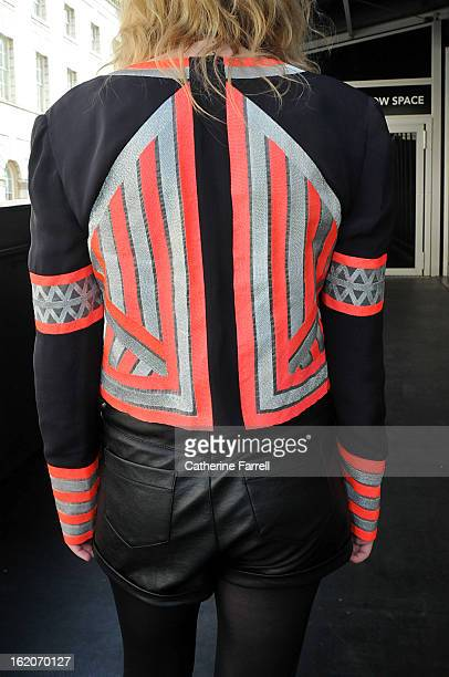 Fashion photographer Katie Boyle from Melbourne Australia seen wearing a Sass and Bide jacket with two stone metallic and fluorescent salmon urban...