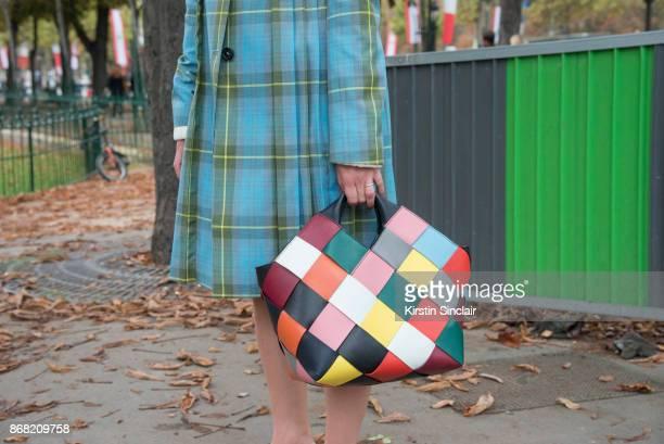 Fashion photographer Masha Mel wears a Burberry coat Loewe bag day 3 of Paris Womens Fashion Week Spring/Summer 2018 on September 28 2017 in London...