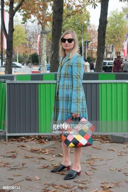 Fashion photographer Masha Mel wears a Burberry coat, Loewe bag, Prada sunglasses and Balenciaga shoes day 3 of Paris Womens Fashion Week...