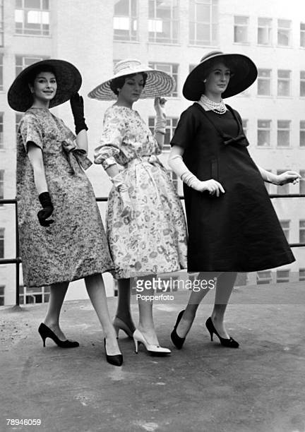 29th September 1954 Outfits from French designer Christian Dior being modelled in London leftright an afternoon dress in printed silk an afternoon...