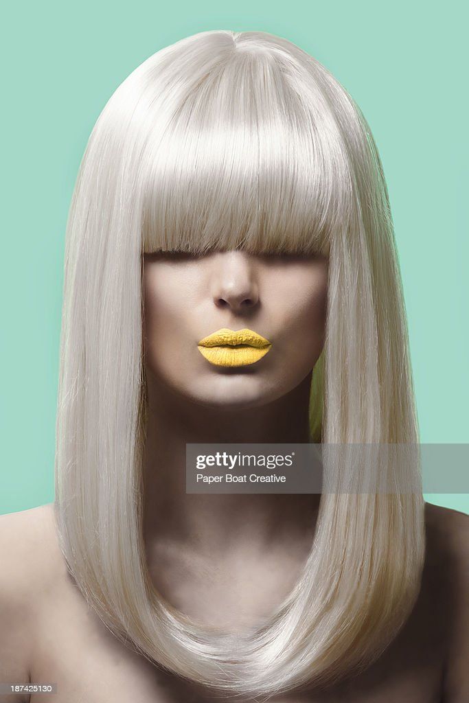 fashion picture of a lady with blonde hair : Foto de stock