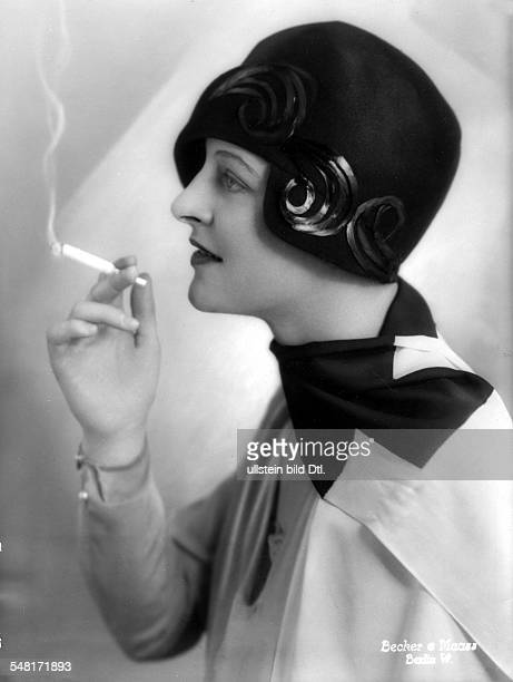 Fashion pictures Miss d'Orloff wearing a black felt hat with appliques designed by Gerstel 1928 Published by 'Die Dame' 12/1928 Vintage property of...