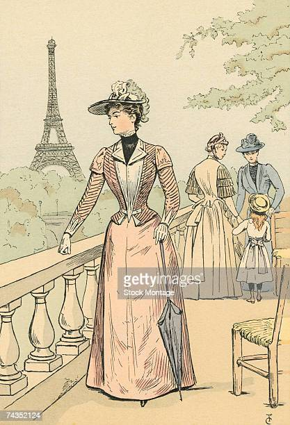 Fashion plate by French artist Francois Courboin entitled 'The Eiffel Tower from the Exposition Gardens' shows a fashionably dressed woman as she...