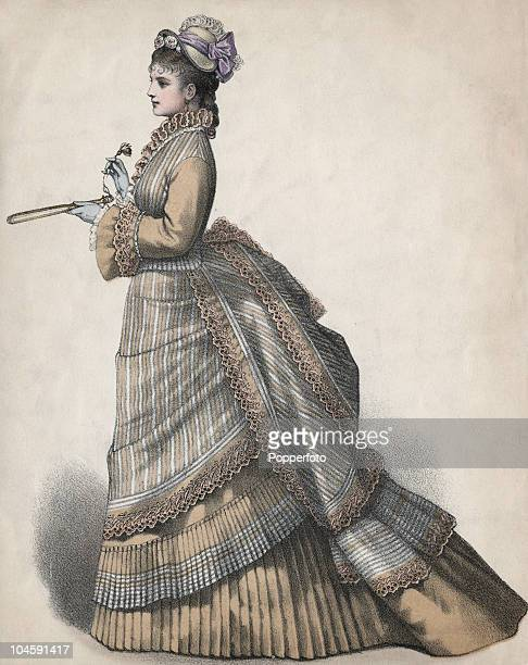 A fashion plate showing a woman in a fashionable fulllength dress with bustle circa 1875