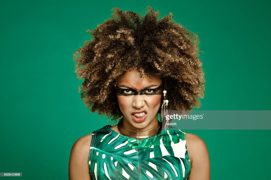Fashion portrait of angry female warrior : Stock Photo