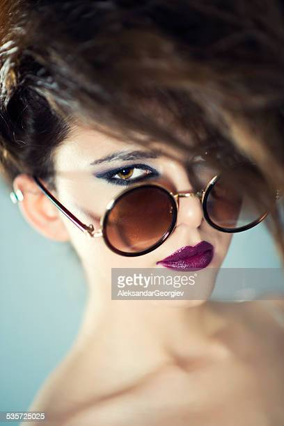 Fashion Portrait of Beautiful and Stylish Young Woman With Sunglasses