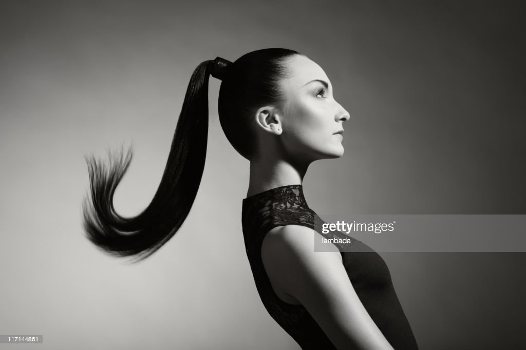 Fashion portrait of beautiful woman with ponytail : Stock Photo