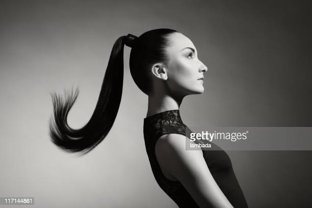 Fashion portrait of beautiful woman with ponytail