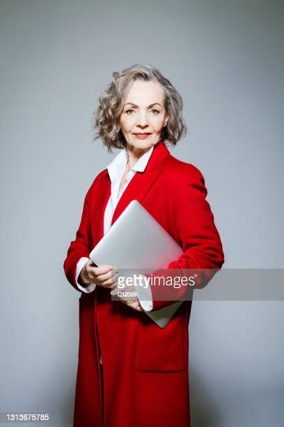 fashion portrait of confident senior businesswoman - red stock pictures, royalty-free photos & images