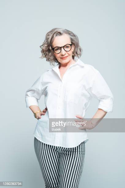 fashion portrait of elderly businesswoman - mature adult stock pictures, royalty-free photos & images