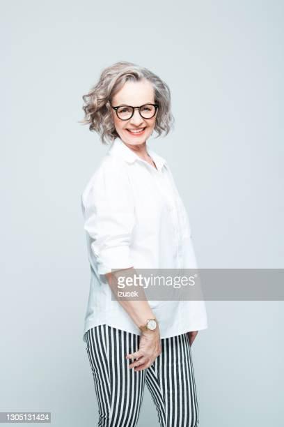 fashion portrait of elegant senior woman - izusek stock pictures, royalty-free photos & images