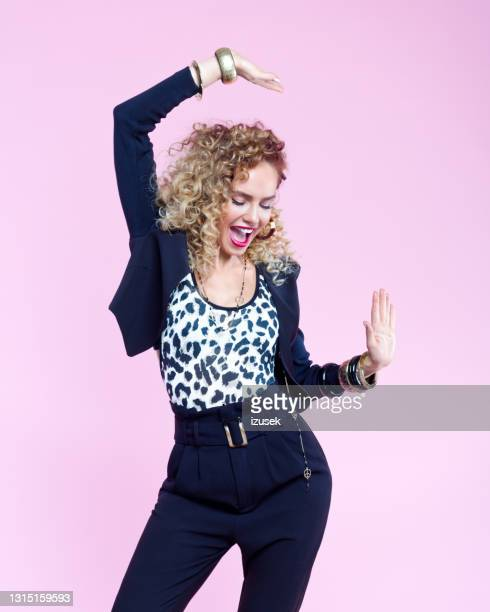 fashion portrait of happy woman in 80's style look - 20th century stock pictures, royalty-free photos & images