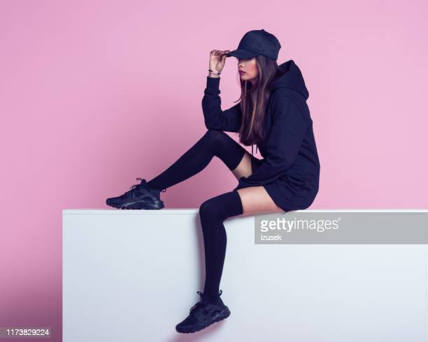 fashion portrait of rebel young woman - knee length stock pictures, royalty-free photos & images