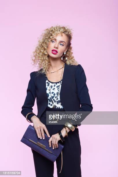 fashion portrait of woman in 80's style look - pink purse stock pictures, royalty-free photos & images