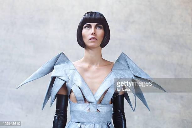 fashion portrait of woman in futuristic clothes - grey dress stock pictures, royalty-free photos & images