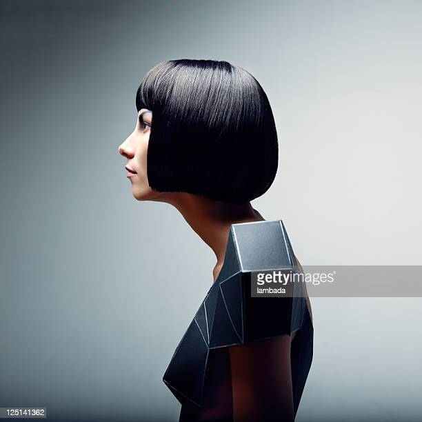 fashion portrait of woman in futuristic dress - bobbed hair stock pictures, royalty-free photos & images