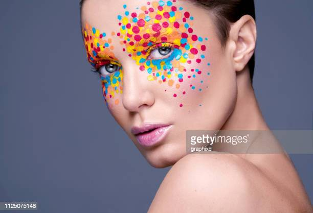 fashion portrait of woman with artistic colorful make-up - saturated colour stock pictures, royalty-free photos & images