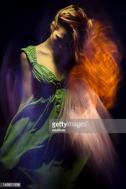 fashion portrait of young woman on black background. - long dress stock pictures, royalty-free photos & images