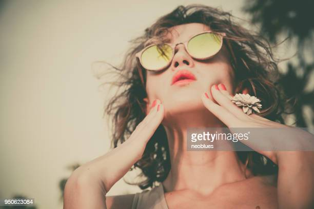 fashion portrait pretty sweet woman blowing red lips - permed hair stock photos and pictures