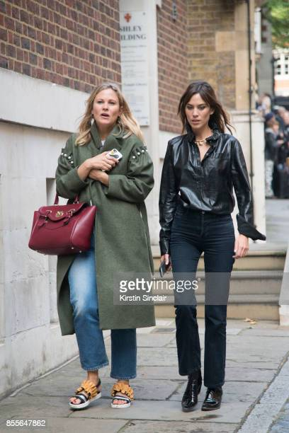 Fashion Pr Liz Mathews wears a Mother of Pearl jacket and a Hill and Friends bag with British writer host model and fashion designer Alexa Chung...