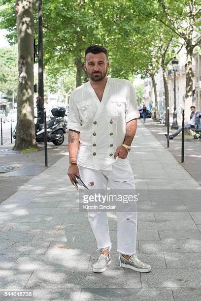 Fashion PR Mattia Paterlini wearing a Balmain shirt Levis jeans Christian Louboutin shoes on day 4 of Paris Collections Men on June 25 2016 in Paris...