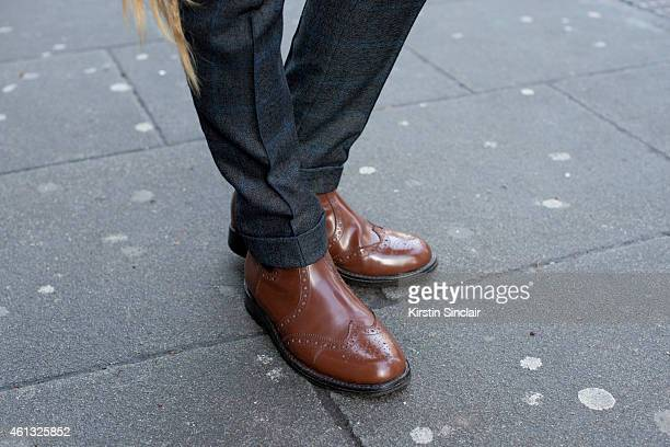Fashion PR Sava Ionut wearing a Florin Dobre suit Samual Winston shoes day 2 of London Collections Men on January 10 2015 in London England