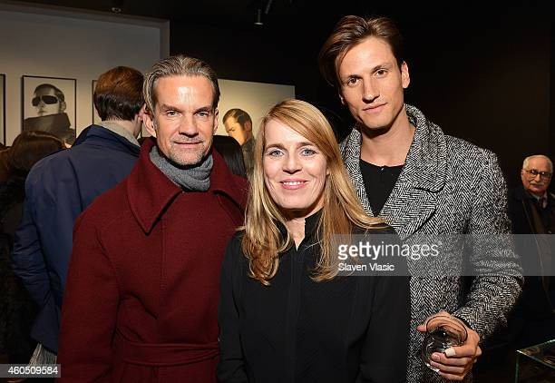Fashion producer Alexander Werz Kerstin Hamann director of marketing and public relations for Porsche Design of America and model David Florentine...