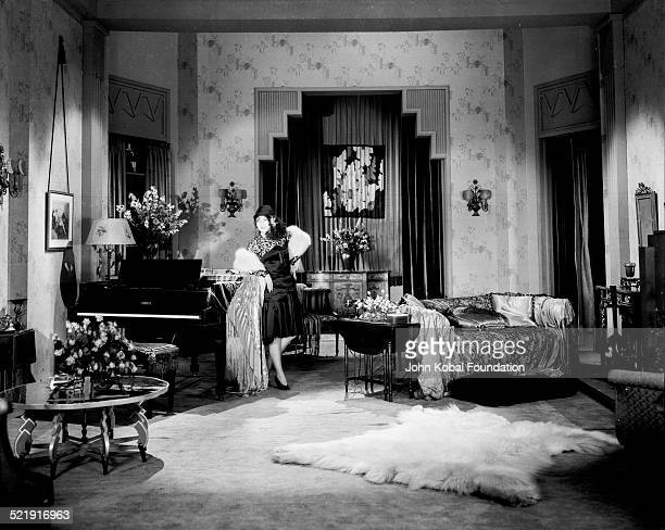 Fashion publicity shot of actress Nancy Carroll a hat and fur stole in a sitting room for Paramount Pictures 1929