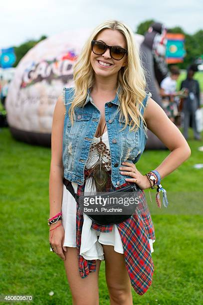 Fashion Rep poses wearing with Topshop jacket and shrt with Style As dress and Gandys flip flops at The Isle of Wight Festival as Seaclose Park on...
